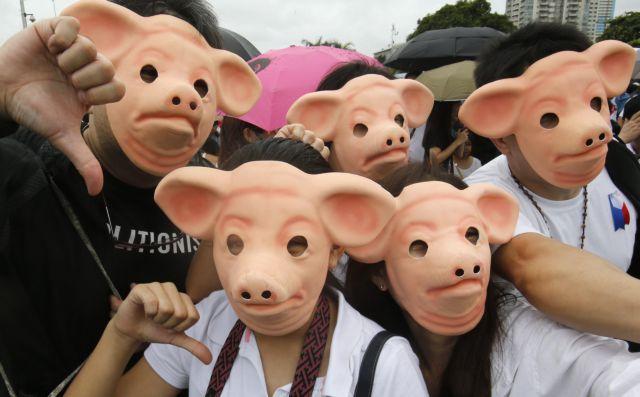 Μαζική διαδήλωση στη Μανίλα για τον... άδειο «κουμπαρά» των ζώων | tanea.gr