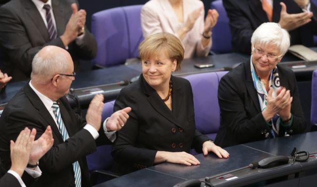 Με 462 ψήφους εξελέγη για τρίτη φορά καγκελάριος η Μέρκελ   tanea.gr