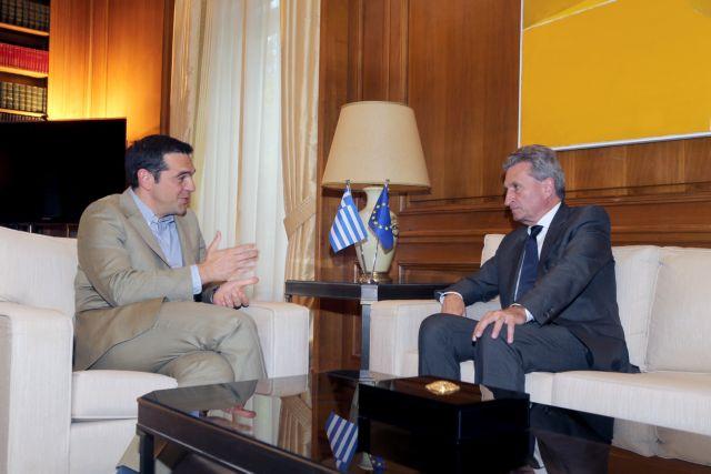 Στην Αθήνα ο επίτροπος Ετινγκερ - Συνάντηση με Τσίπρα   tanea.gr