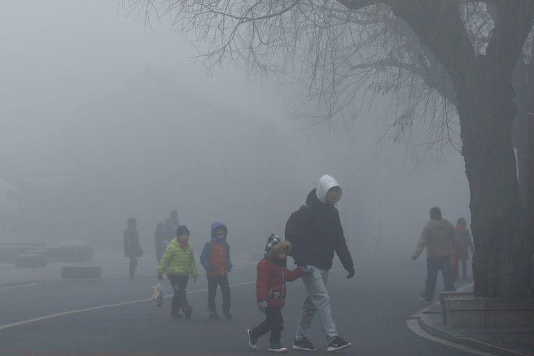 Πορτοκαλί συναγερμός λόγω νέφους στο Πεκίνο | tanea.gr