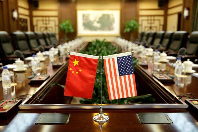 Λύση στις εμπορικές τριβές Κίνας-ΗΠΑ ζητά ο Κινέζος κεντρικός τραπεζίτης   tanea.gr