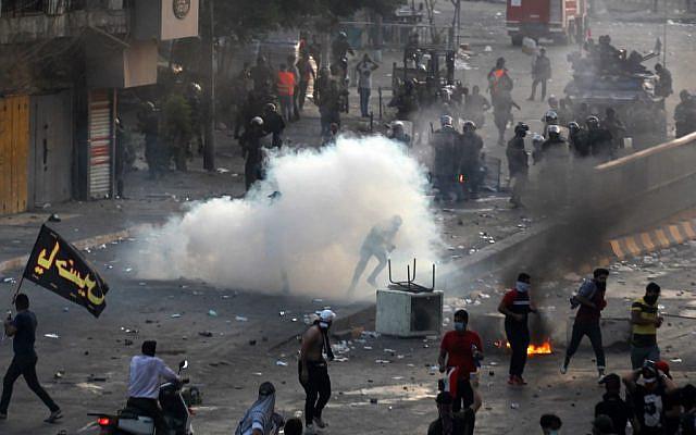 Βαγδάτη : Νέες σφοδρές συγκρούσεις διαδηλωτών με τις δυνάμεις ασφαλείας   tanea.gr